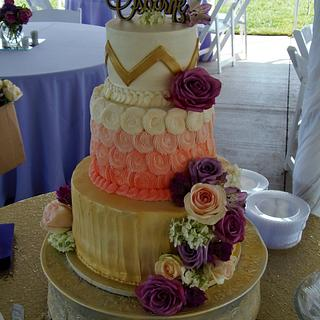 Gold, coral, and purple BC wedding cake