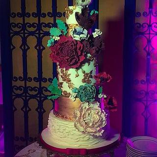 Ruffles, bas relief and sugar flowers on white and bronze cake