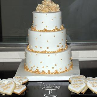 Gold and white wedding cakes