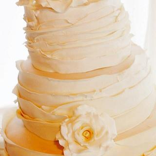 Wedding cake with ruffles and roses