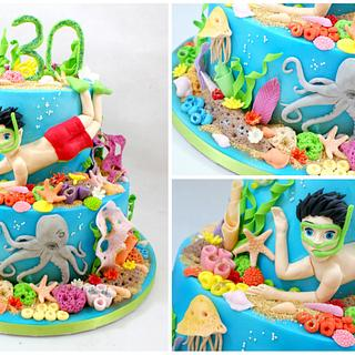 cake with a coral reef and diver