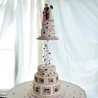 Wedding cake with photos and frames.