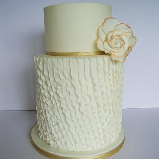 Diagonal ruffles with a large flower etched in gold.