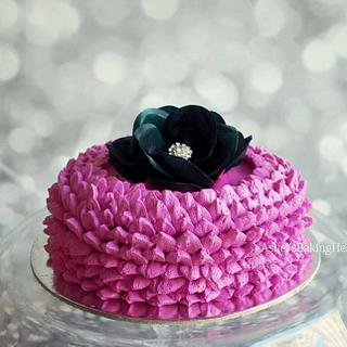 A pretty lotus cake with wafer paper rose
