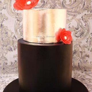 Navy and silver leaf wedding cake