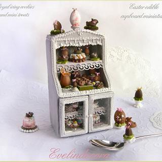 Edible miniature food on cookie cupboard