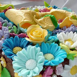 Cake with flowers and yellow Ribbon