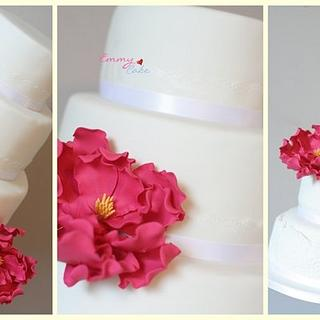Modern wedding cake with lace and pink
