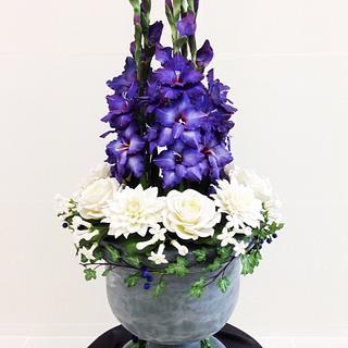Sugar flowers arrangement  in an urn cake.