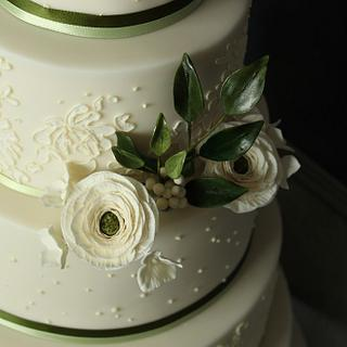 Cream and olive ranunculus wedding cake