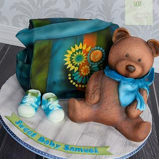 Baby shower diaper bag cake and teddy bear