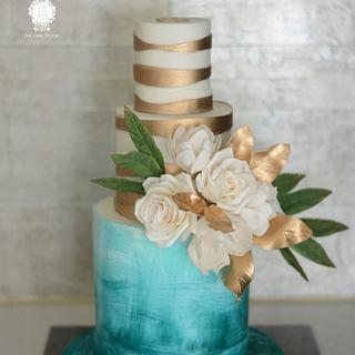 Teal White an Gold Cake