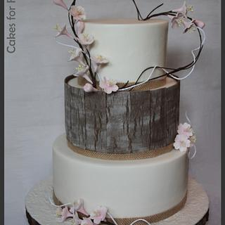 Blossom wedding cake with wood panels
