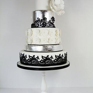 Silver leaf magnolia and black lace cake