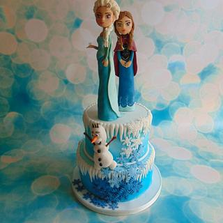 Frozen cake with modelling chocolate figures