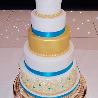 Gold lace and peacock blue wedding cake