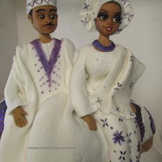Cake topper - couple in the traditional attire (a touch of white & purple)