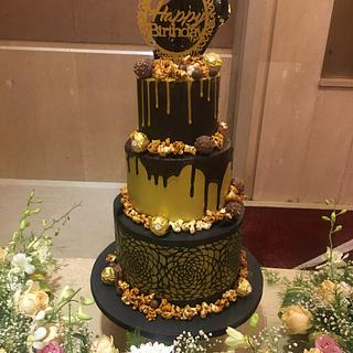 Black and gold birthday cake