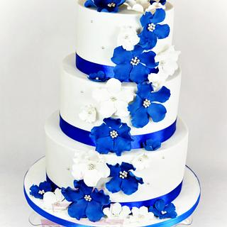 wedding cake with blue and white flowers