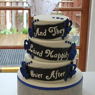 "Royal blue, black and white "" and they lived happily ever after"" wedding cake"