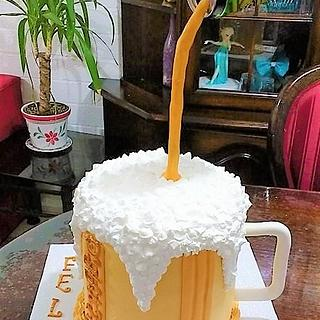 Cake design beer in cream topping