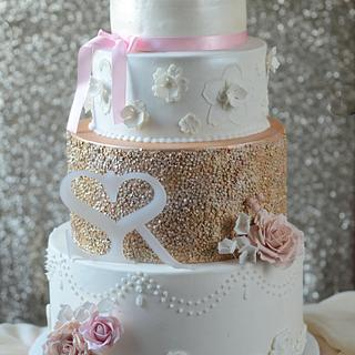 White and gold sequined engagement cake