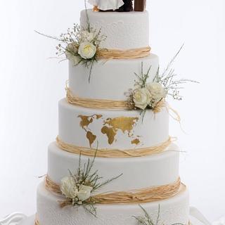 Golden world map wedding cake