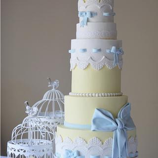 lemon, white and baby blue cake