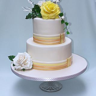 Small wedding cake with yellow rose