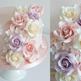 Birthday cake with cascading sugar flowers