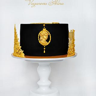 black and gold cake with logo