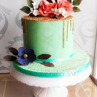 Gold and teal flowers cake