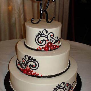 Buttercream Black and Red Flourish Wedding Cake