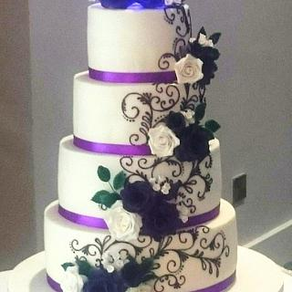 Purple Roses and Piped Scrolls wedding