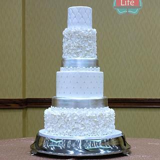 Elegant ruffle silver leaf wedding cake