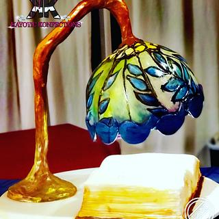 Suspended Tiffany lamp and book