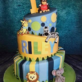 Topsy turvy jungle animals cake