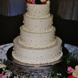 Buttercream and silver dragee dot wedding cake