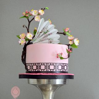 cake with blossom and fan