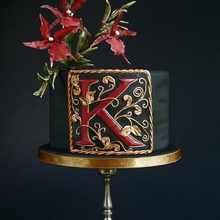 Black cake with a monogram