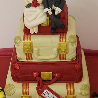 4 Tiered suicase wedding cake