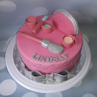 Make-up cake in pink and silver.