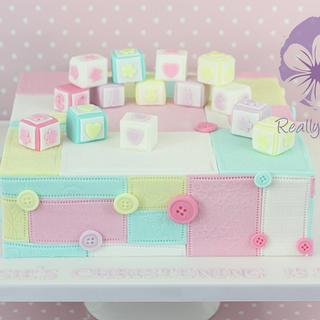 Christening cake, with patchwork and baby blocks
