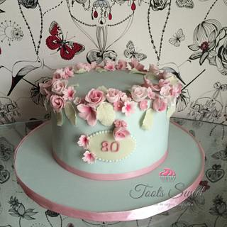 Halo Rose and cherry blossom cake
