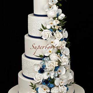 White orchids and blue hortensia wedding cake