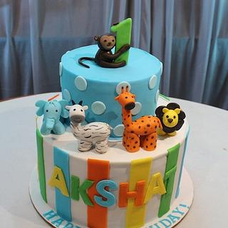 Animals theme 2 tier fondant cake for boys 1st birthday