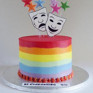 Buttercream rainbow stripe theatre masks cake