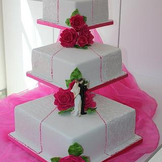 3 Tier square embossed wedding cake with Hot pink handmade roses
