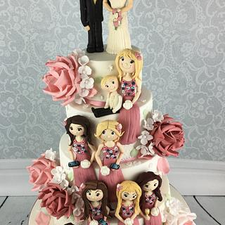 Dusky pink wedding cake with 10 sugar figures