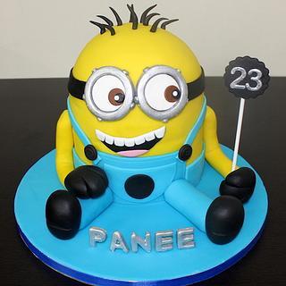 Cute Minion shaped 3D fondant cake for girls birthday